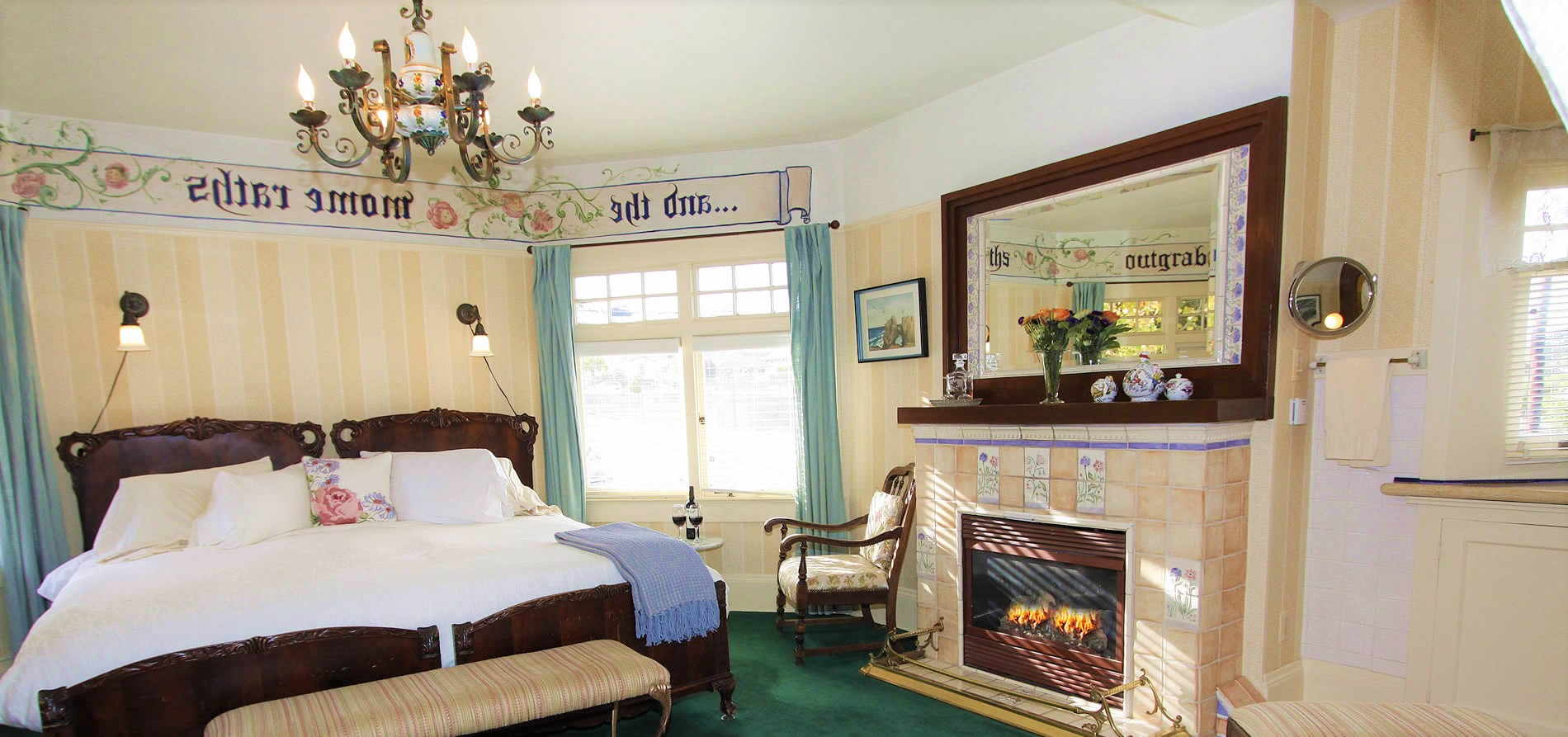 monterey bed and breakfast guestroom with fireplace, bed and chair