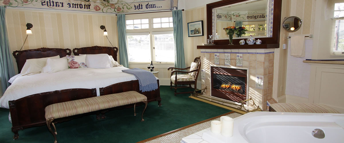monterey bay bed and breakfast room with ocean views, fireplace and spa tub