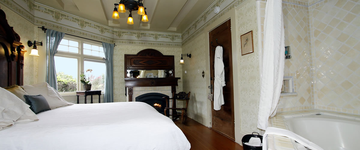 monterey bay bed and breakfast room with spa tub, fireplace and antiques