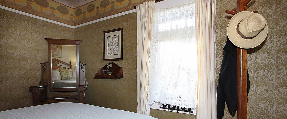 monterey bay bed and breakfast room with ocean views, bed and desk
