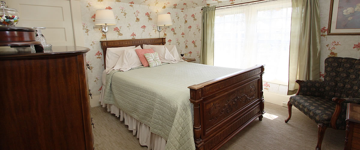 monterey bed and breakfast wabe room with queen bed and dresser
