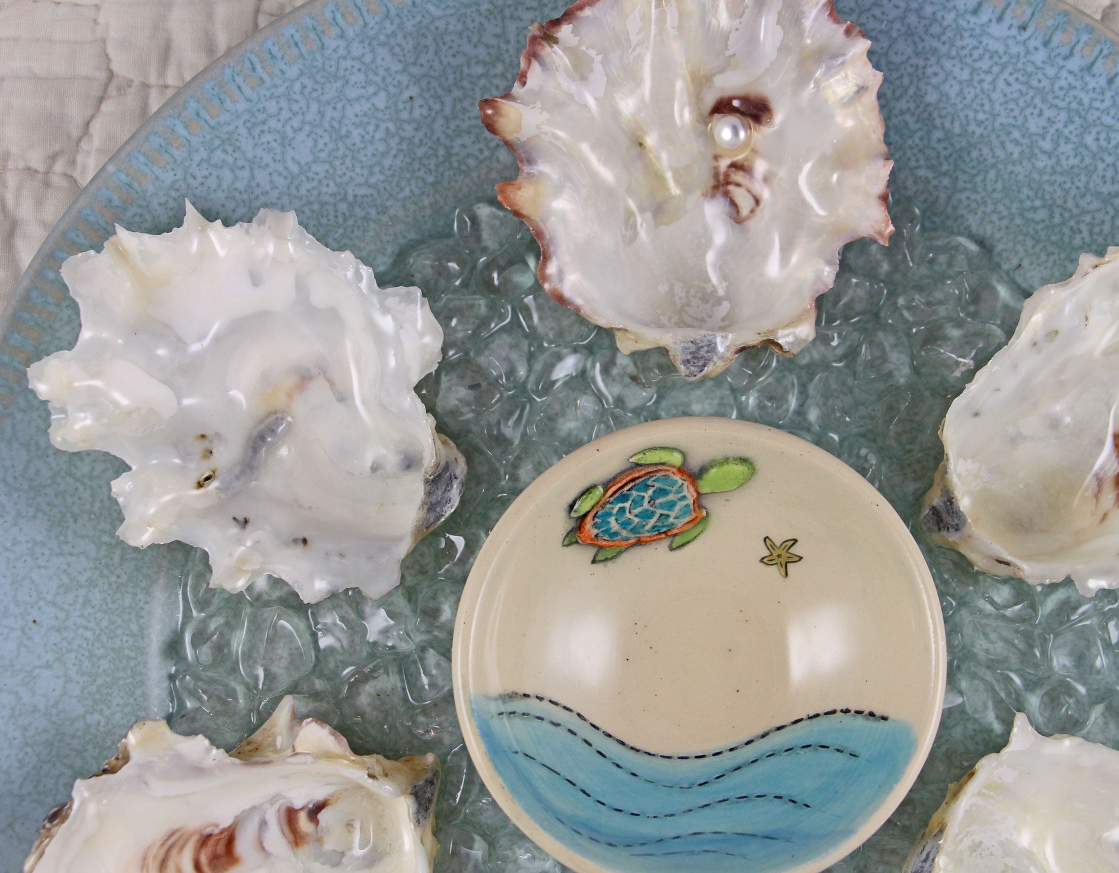 Collectible oyster plates and seashell clocks.
